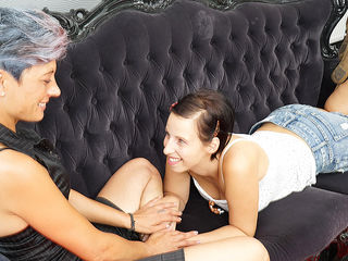 Horny old and young lesbian couple make out on the couch
