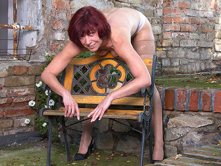 Naughty pierced mature lady playing with herself outside