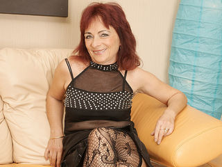 Mature redhead loves to work her hairy pussy