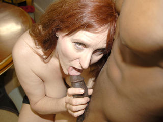 Horny red mature slut getting fucked by a hard black cock
