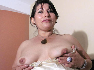 Hot mama playing with a big toy