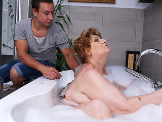 Mature BBW fucking and sucking her toy boy in bath