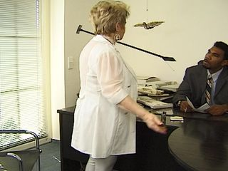 Granny gets owned by a black hunk, down at the office