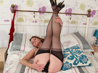 Horny British mom playing with herself
