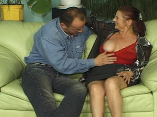 Mature rides cock on the couch until she hits the orgasm