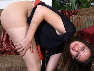 Naughty American mom playing on the couch