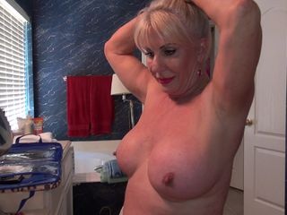 Busty granny loves flashing naked around the house