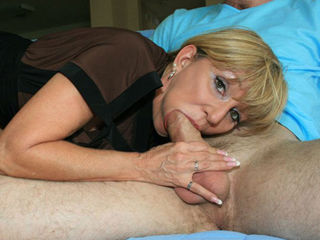 Big cocked Brent is caught jacking off again, when milf Mrs. Sexton catches him in the act, she decides to help him out. Just let me suck it and get it over with already! Says the perverted mom. As Brent kicks back, Mrs. Sexton gives him a sloppy blowjob into a massive facial cumblast.
