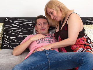 Curvy housewife enjoying her time with a horny toy boy