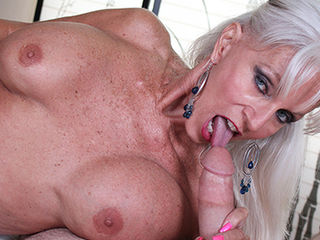 Naught granny Sally DAngleo is horny as fuck and decide to suck off her granddaughters new boyfriend for fun. She easily seduces the young boy with her massive rack and sensual voice. The poor guy has no choice but to pull out his throbbing cock for her to suck on.