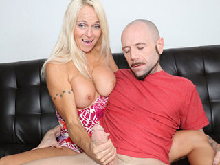 Hot blonde MILF Dani Dani is horny as fuck and Dom isnt having it during his precious game watching time. But during the seventh inning stretch Dani offers to give him a stretch in a whole different way by giving him a hot reach around handjob. Dom quickly loses his focus and eventually spurts his warm white semen from Danis incessant stroking.