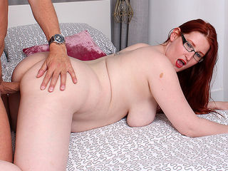 Curvy red haired cougar fucking and sucking her lover