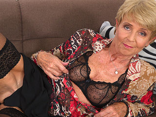 Horny granny playing with her wet pussy