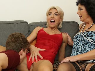 Two horny Milfs share their toyboys cock in hot threesome