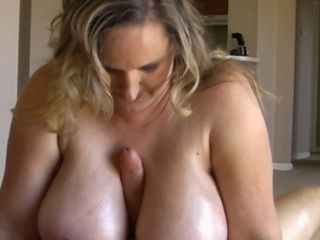 Massive boobed mother Seanna loves big strong cocks. When she entices young Joey to whip it out, the horny mom lets him fuck her massive 44G juggs. Joey092;s big pecker disappears between her tits and spurts his goo all over them.