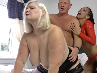Violette and Lacey take turns deep throating a thick cock in this wild threesome!